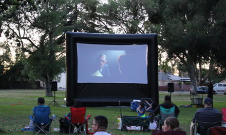 Families gather for summer movie in the park in Atwater