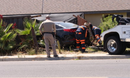 Vehicle crashes through two fences before striking house in Winton